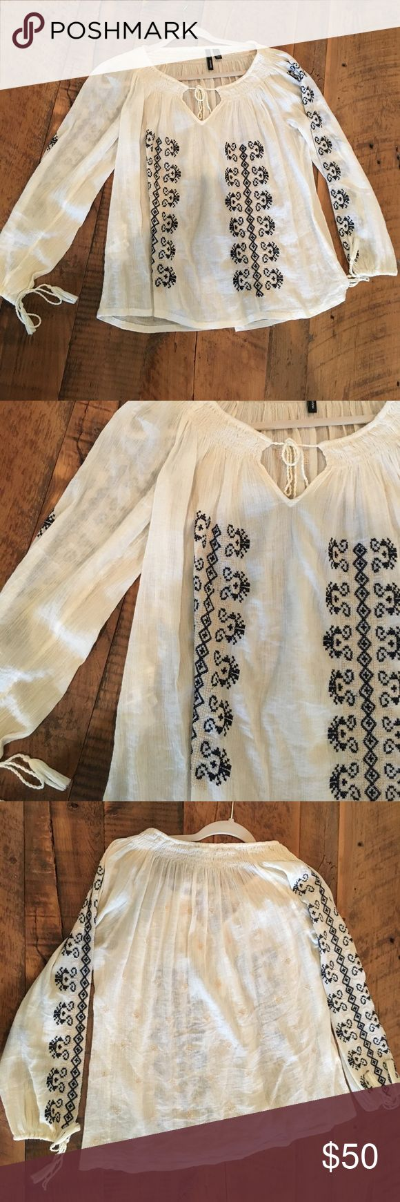 Too from the European store Mango Flowy top with cute design on the sleeves and front! It is a US Xs but runs big so I would describe it closer to a small! Mango Tops Blouses