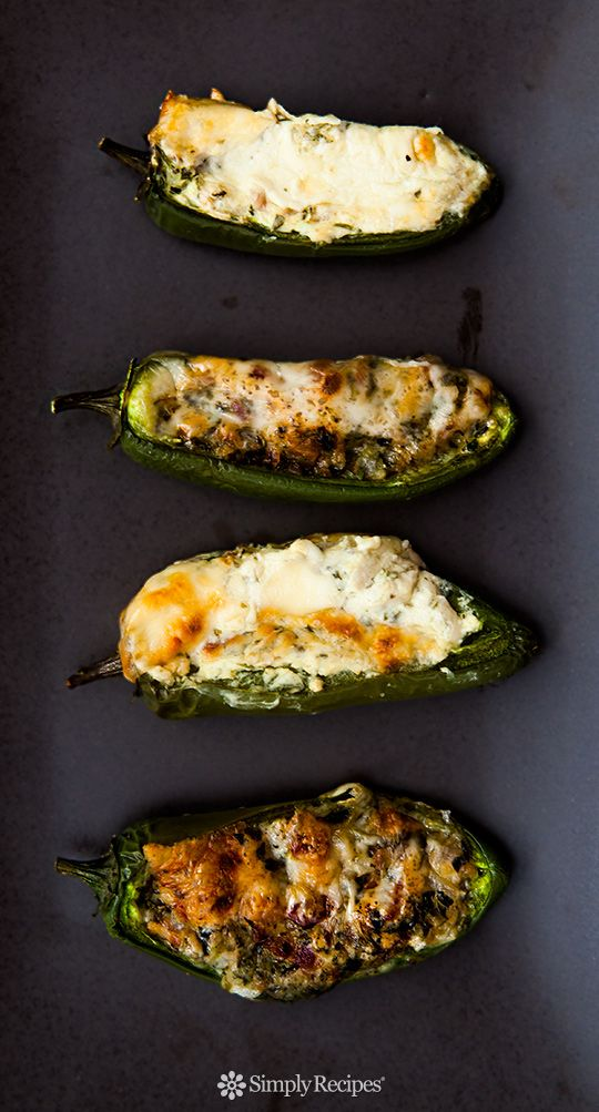 Baked jalapeños stuffed with cheese, onions, cilantro and bacon, seasoned with oregano and cumin. Perfect appetizer for Game Day! On SimplyRecipes.com