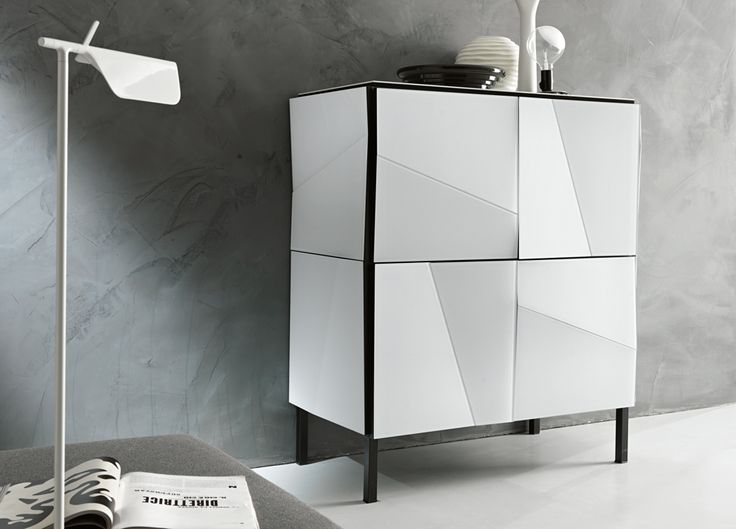 A black framed High gloss white cabinet in a structured design