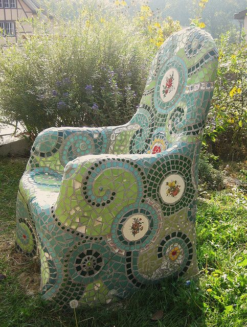 Regular metal garden chair. Cover with chicken wire and concrete then mosaics.