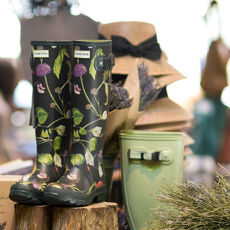 """Topped with a gorgeous floral print from the Royal Horticultural Society archives, these tall rubber boots are hand-crafted by Hunter using flexible and waterproof rubber.- Rubber- Handmade- Store out of direct sunlight to prevent fading- ImportedWomen's sizes 5-1114.5""""H, 1"""" heelFor 1/2 sizes, order next size down. Boots run large to allow for socks in cold weather."""