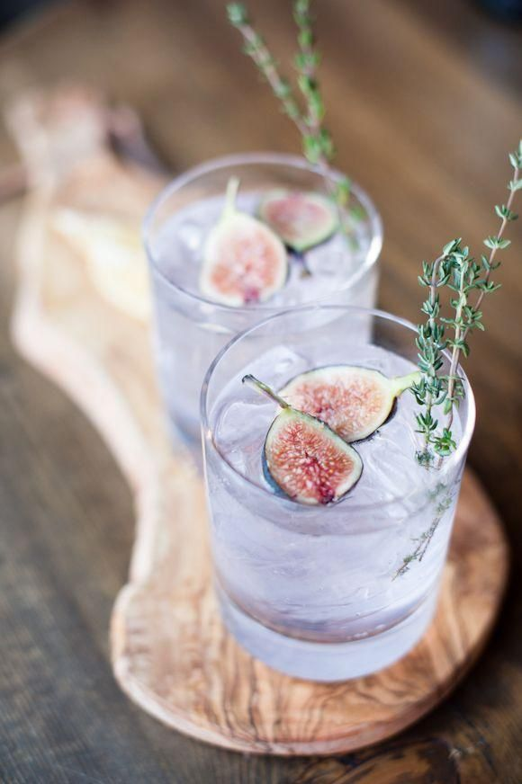 This fancy fig cocktail made with fresh figs and thyme has the prettiest pale lavender color and is the perfect refreshing cocktail for fall!