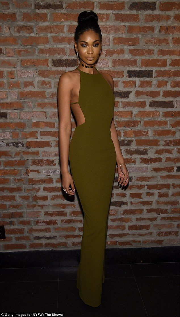 Elegant: Chanel Iman showed off her model credentials in a khaki column dress with cut-outs down the sides