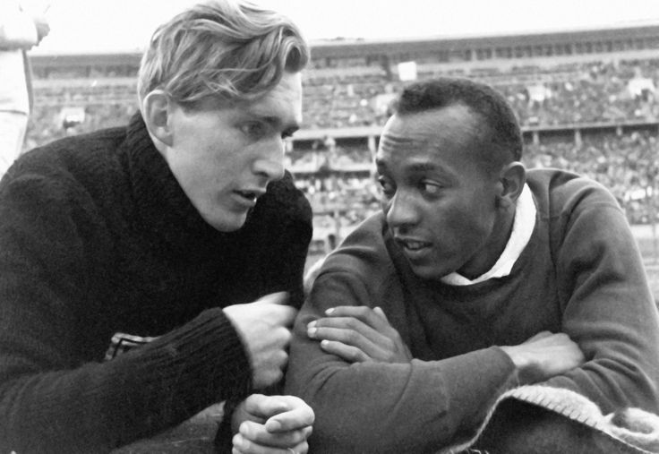"""American Jesse Owens talking with German Ludwig """"Luz"""" Long at the 1936 Nazi Olympic Games. Despite the tensions between their nations and being competitors in the long jump, the two developed a friendship, with Long giving Owens pointers on how to..."""