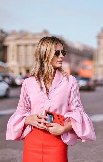 High style in ruffled sleeves and a bright skirt.