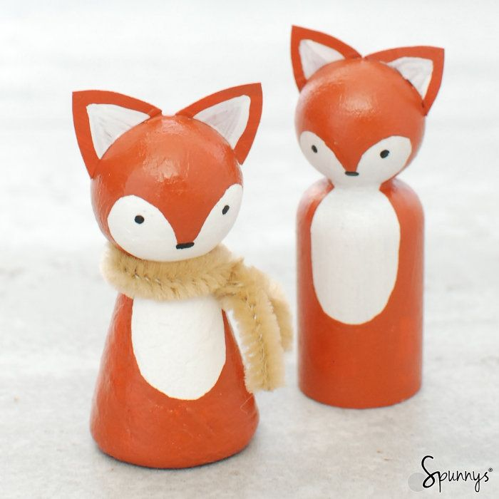 Wooden peg dolls (right) vs paper peg dolls (left) - a comparison. The same fox pattern was painted on the two different kind of peg dolls.