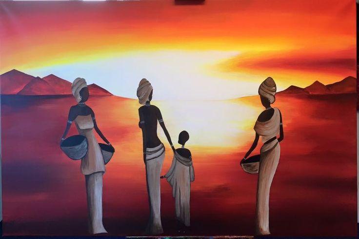 Afrikaanse vrouwen en kind tijdens een zonsondergang