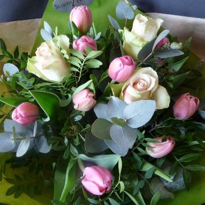 A beautiful handtied bouquet of dreamy pink Roses, pink Tulips, foliages and Eucalyptus leaves.   Part of our Mothers Day 2016 Collection.
