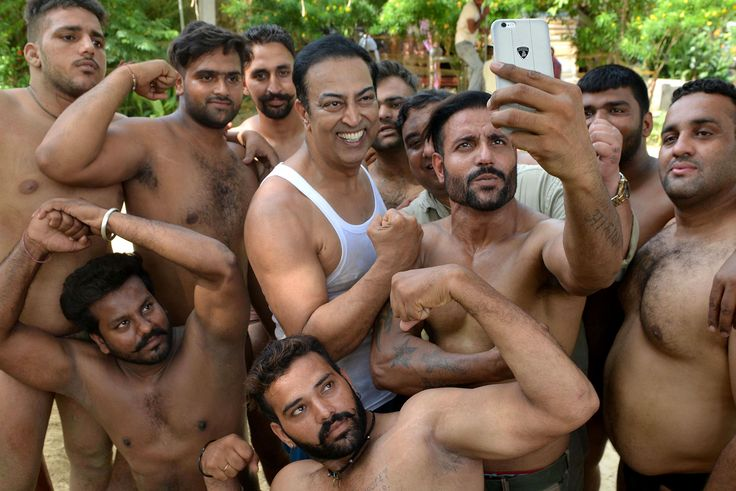 "Indian Bollywood actor Vindu Dara Singh (center) poses with wrestlers, or <i>Pahalwan</i> performers, during the filming of the video for a the Punjabi song ""Kaun Hai Number One,"" directed by Vikas Dutta, on the outskirts of Amritsar on August 11, 2017."