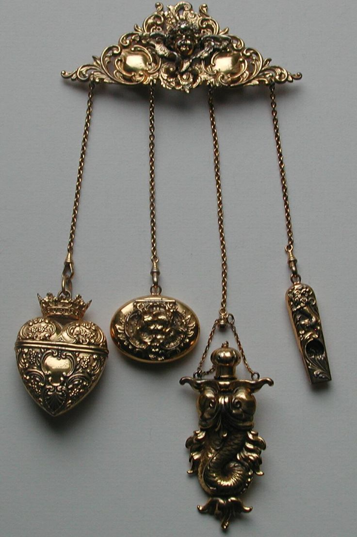 Art Nouveau Kerr Vermeil Chatelaine with Attachments -- Stunning cherub chatelaine with original attachments.  Attachments are as follows:  F Heart Needle Case, Kerr Kissing Cherub Patch Box, Kerr Sea Creature Perfume/Vinaigrette,  F Lion Whistle.  All attachment pieces are in mint condition and are marked sterling and with their maker's marks.  Chatelaine brooch is unmarked and has some wear to the gold wash and the cherub's nose.