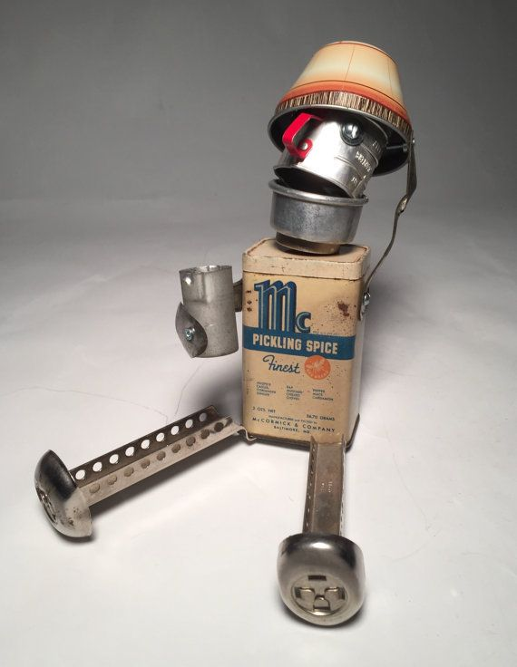 This tiny tipsy tin is Just Little Bot Pickled?  Hes an assemblage art sculpture I made from recycled materials including:  • vintage spice tin • toy