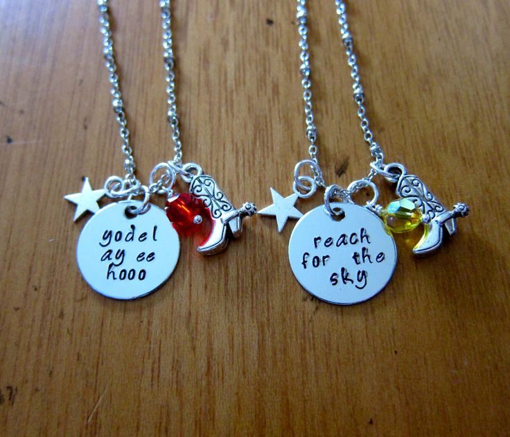 "Toy Movie Inspired Friendship Necklaces. Sheriff Woody & Cowgirl Jessie ""Reach for the Sky"" ""yodel-ay-ee-hooo"". Set of 2. by WithLoveFromOC (item: 2015102630)"