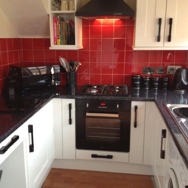 Red white and black small kitchen