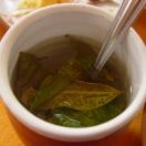 Coca tea in Cusco, Peru. I apparently didn't drink enough of this; I had some altitude sickness and was afraid I wouldn't be able to travel on to Machu Picchu! Doctor made a house call to my room, gave me drugs and brought oxygen. Total cost for the doctor visit, drugs & oxygen? Fifteen U.S. dollars.