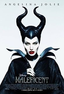 A vengeful fairy dressed black with her black horns standing and the film's title below
