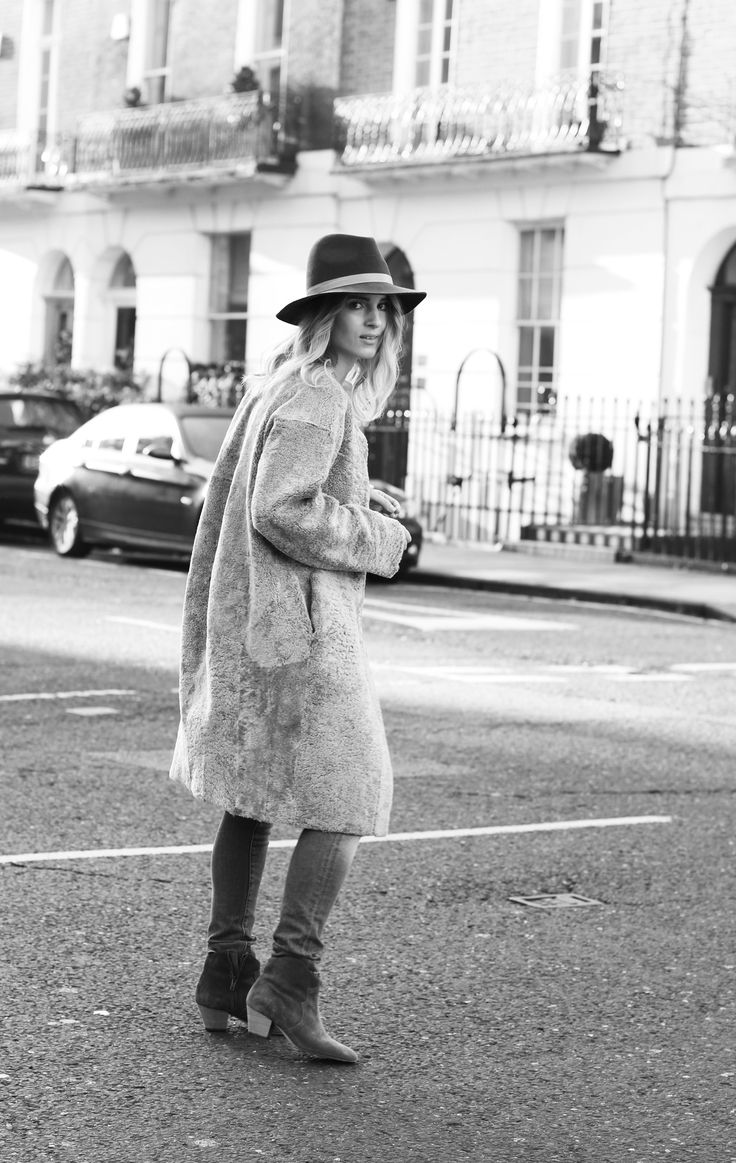Iris & Ink teddy coat, Janessa Leone hat & Isabel Marant dicker boots. Via Mija