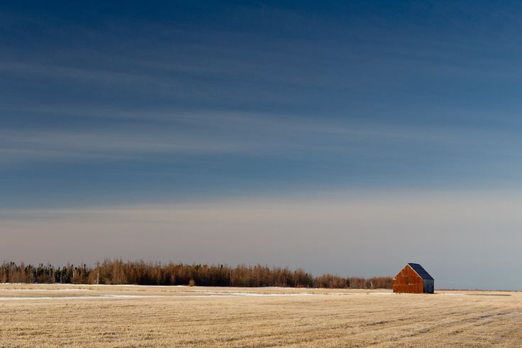 """At one time, there were almost 400 hay barns on the Tantramar Marsh, dotting the landscape for as far as the eye could see. Now, only a dozen remain. They have long attracted photographers and painters to the area and have always been a symbol of the marshes. But, one day soon, the barns will survive only as photographs, and paintings, and memories."""