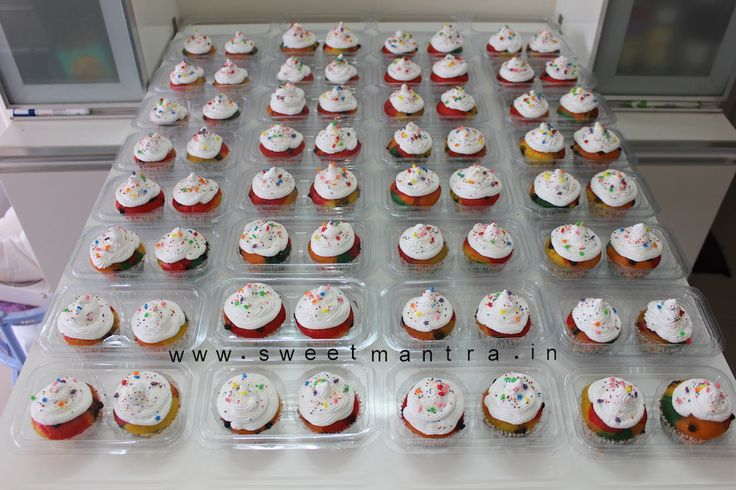 Rainbow theme customized multicolor colorful eggless fresh cream cupcakes for kid's 1st birthday at Baner, Pune