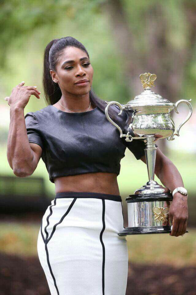 Looking like a champ in that cute skirt (Serena Williams holding her French Open 2015 trophy)