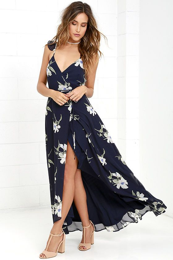 You'll find everything you're looking for, and more with the All Mine Navy Blue Floral Print High-Low Wrap Dress! Breezy Chiffon with a cream, periwinkle, and green floral print sweeps over a strappy, ruffled wrap bodice with tying waist. High-low midi skirt with front slit.
