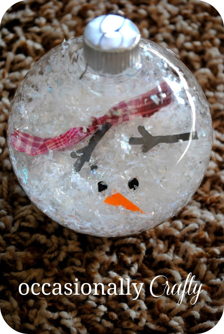 Melted Snowman Ornament :     Clear ornaments         Fake snow or shredded white paper Cut out snowman parts  fabric for  scarf Funnel  put fake snow in ornament.  add snowman parts  move them til you're satisfied.