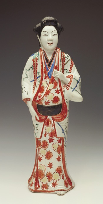 Figure of a standing woman  1670-1700      Edo period     Porcelain with enamels over clear colorless glaze  H: 38.5 cm   Arita, Japan