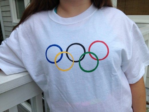 Make an Olympic Rings T-Shirt, put the child's name on the back & give each group of children a different color t-shirt to represent different teams.