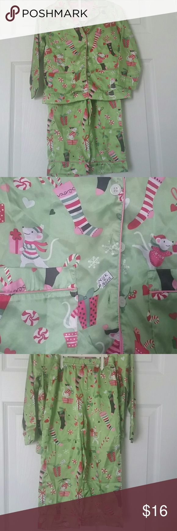 Nick & Nora Christmas Pajamas Light green satin pajama top and pant set trimmed in pink.  Has the adorable nick and Nora mice adorned in red and pink.  Fabic covered in Christmas stockings, gifts, candy canes, hearts, and mouse characters.  Long sleeve top buttons up front and has pockets.  elastic waist pants. Nick and Nora Pajamas Pajama Sets