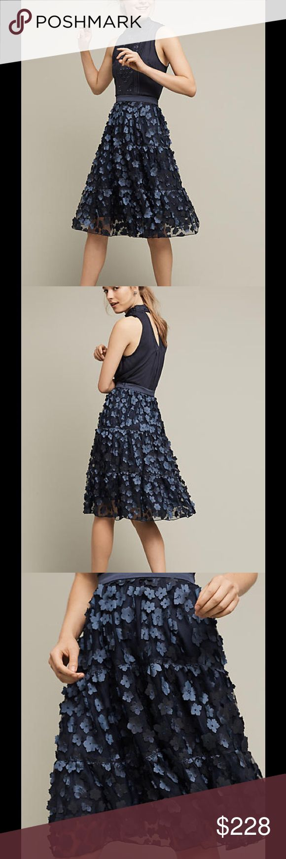 Eva Franco Blue Buttercup Midi Skirt A field of blue flora pops on this eccentrically charming midi. Made in the USA by Eva Franco.  Polyester; polyester lining Midi silhouette Side zip Dry clean USA Eva Franco Skirts Midi