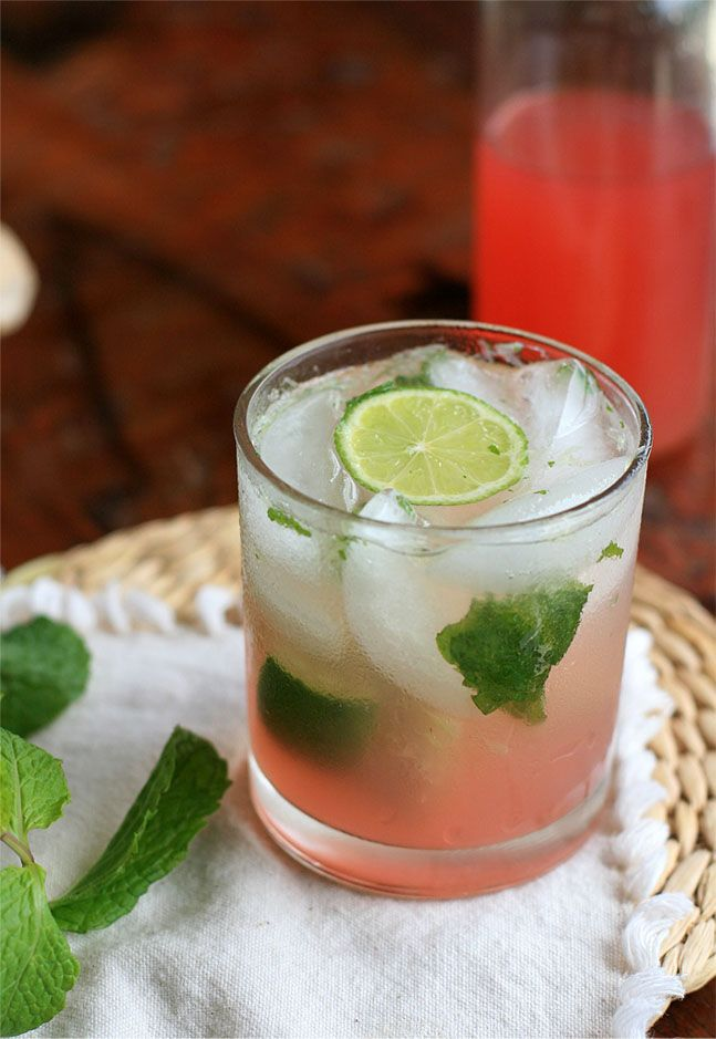 rhubarb and ginger mojito - mint leaves, lime, rhubarb and ginger syrup, white rum, ice, water, slice of lime to garnish