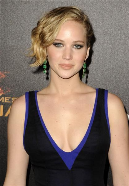 """Jennifer Lawrence is so gorgeous, we don't even mind her awkward asymmetrical hairdo. And here's good news for any J.Law lovers out there: The """"Hunger Games"""" starlet is back on the market after calling it quits with off-and-on love Nicholas Hoult (again!). And hopefully the rumors about her dating Chris Martin aren't true. RELATED: Jennifer and more of the hottest stars of summer 2014"""
