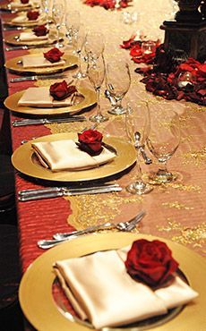 Beauty and the Beast inspired red and gold wedding reception decor