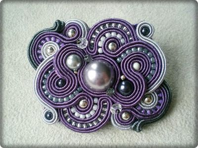 .Like this for a pin or brooch.