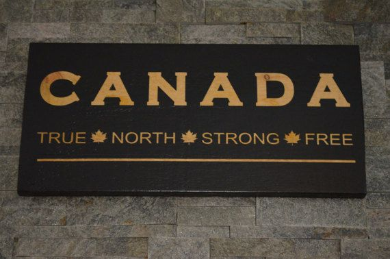 Canada Wood Sign. Canada True North Strong Free. Celebrate Canada 150 Years!!! Show your patriotism. Perfect for your home or cottage. Lets celebrate the great country of Canada! This sign is approx 12 x 24 x 1 thick. Made from solid rough sawn pine, painted with a black background, and white painted lettering. The sign comes with two hooks on the back for sturdy hanging. Our signs are finished with an indoor sealant. All of our products are 100% Canadian Made by us! Please note that eac...