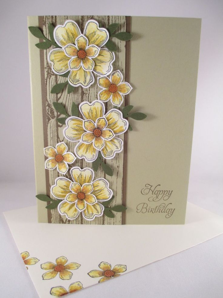 kraft base ... layered stamped and punched flowers on background panel of stamped woodgrain column ... Stampin' Up!