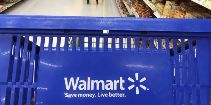 Walmart reported strong holiday sales but said online sales growth slowed during the quarter, marking a turn from three quarters of booming web growth.