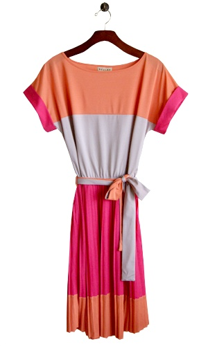 Spring is here girls and this yummy color block of orange sherbet, soda and strawberry punch is sure to put you in an effervescent mood. Wear it to a wedding, a birthday party or better yet, brunch with the in-laws! This sweet version of the shirt dress comes with a reversable orange/grey belt, casual short cuffed pink sleeves and oh so feminine mini pleats for extra swing. So go ahead and toast to Spring!