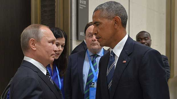Barack Obama expels 35 Russian spies over election hacking row in 'Cold War deja vu'