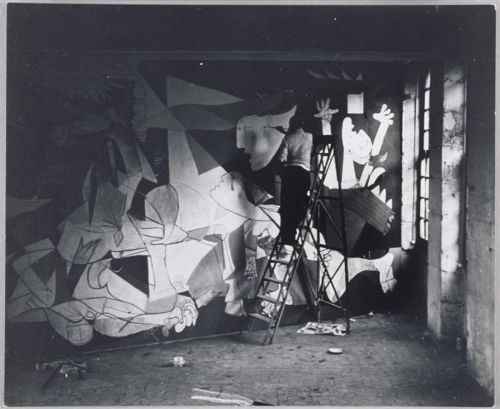 Pablo Picasso works on 'Guernica', commissioned by the Spanish Republicans in 1937 after the aerial bombing of Guernica by the Nationalists, Luftwaffe, and Italian Aviazione Legionaria. Because a majority of Guernica's men were away fighting, the...