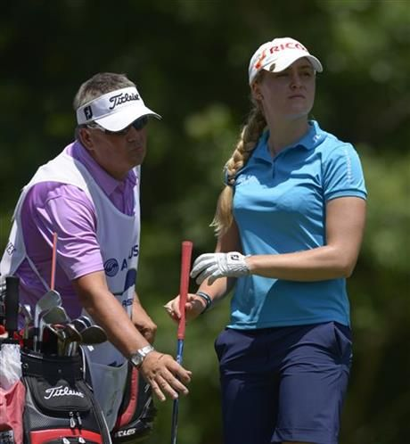 Charley Hull of England hands her club to her caddy after hitting her tee shot on the seventh hole during the second round of the Airbus LPGA Classic golf tournament at Magnolia Grove on Friday, May 23, 2014, in Mobile, Ala. (AP Photo/G.M. Andrews) ▼23May2014AP|Catriona Matthew leads Airbus LPGA Classic http://bigstory.ap.org/article/catriona-matthew-leads-airbus-lpga-classic-0