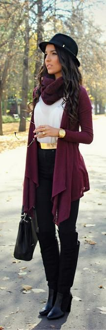 Absolutely LOVE the effortless combination of in trend pieces: burgundy color, gold metallic belt, and black leather riding boots. The fedora pulls it all together