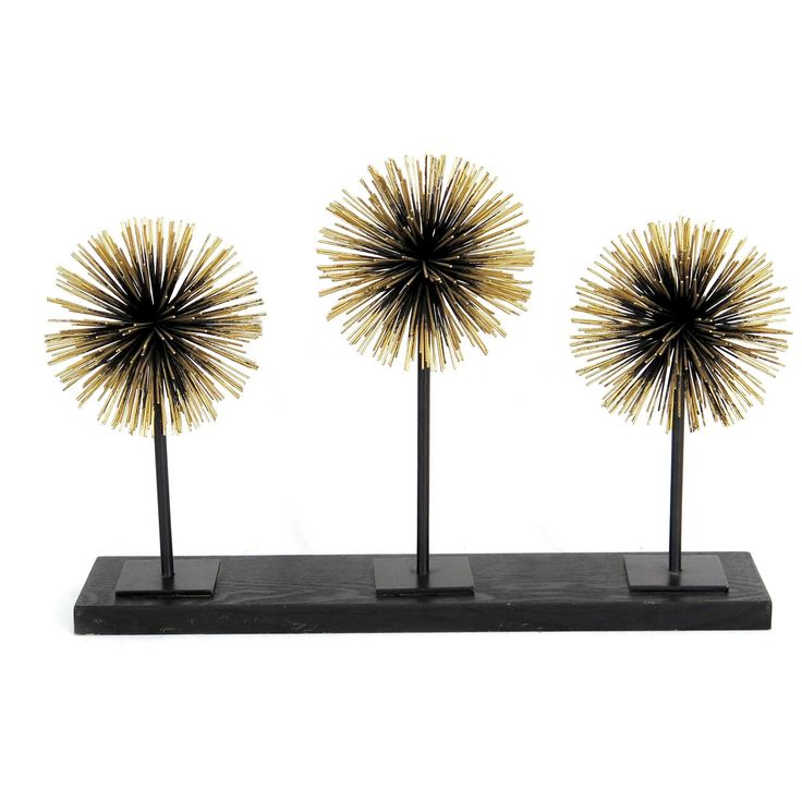 Add style to any room with this contemporary metal tabletop accessory by E2 Concepts for Masterpiece Art Gallery.  This decorative tabletop figurine features a deep bronze & gold finish with three modern starburst silhouettes.  Display this item alone or pair with other decorative accessories by E2 Concepts for Masterpiece Art Gallery.  Wipe clean with a dry cloth.   Each piece sold separately.