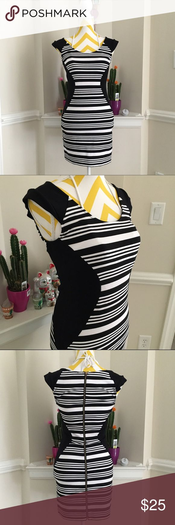 Sexy little black dress Black and white stripes, accentuate the body, with curve hugging design. No pockets. Zips all the way at the back. Stunning. Will fit a size 2. No damage, pristine condition! Send offers thru offer button. Express Dresses Mini