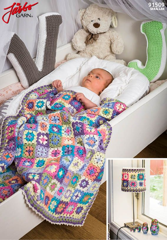 Granny square baby blanket with matching lampshader.