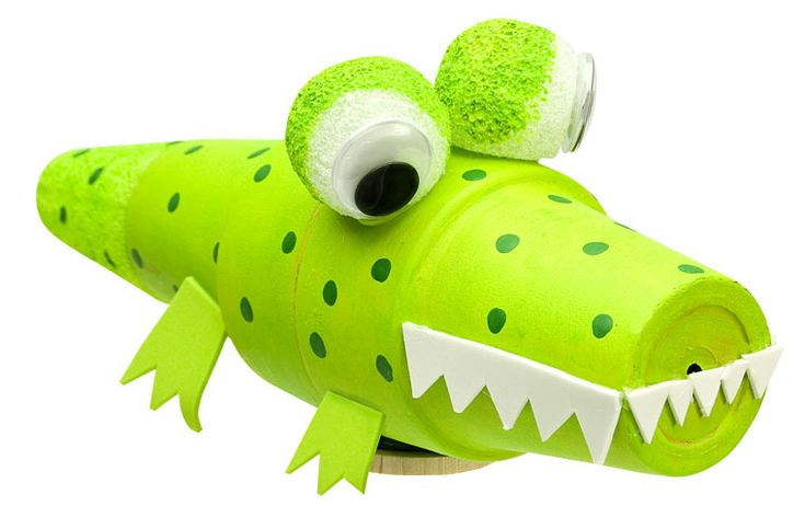 """This cute crocodile project would be fun to complete after reading """"The Enormous Crocodile"""" by Roald Dahl.  This craft project uses pots to form parts of the body, but I think that paper or styrofoam cups could be used instead."""