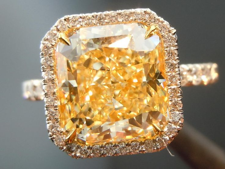 canary yellow diamond in a yellow gold halo setting... LOVE the thin diamond encrusted band & surprisingly the yellow gold looks GREAT with the yellow diamond <3
