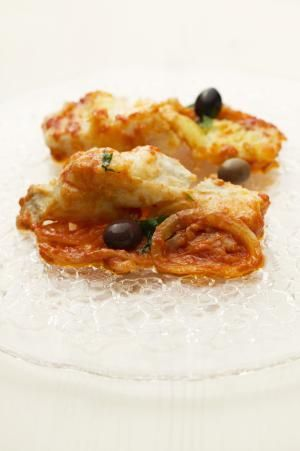 Fried cod fillet with tomato sauce and olives - Nicolas Lemonnier / Getty Images