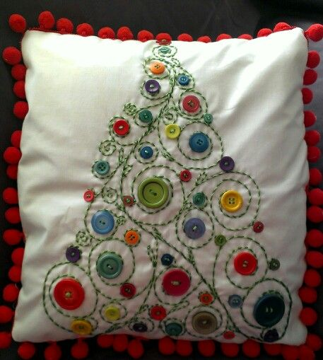 Christmas button embellished cushion - should be fairly easy to recreate. I would probably leave off the pom poms and maybe use red piping instead.