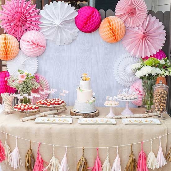 Forget balloons! These paper medallions are sure to lure guests the second they walk into the party. Petite Party Studio doubles up on adorableness with a fringy garland.