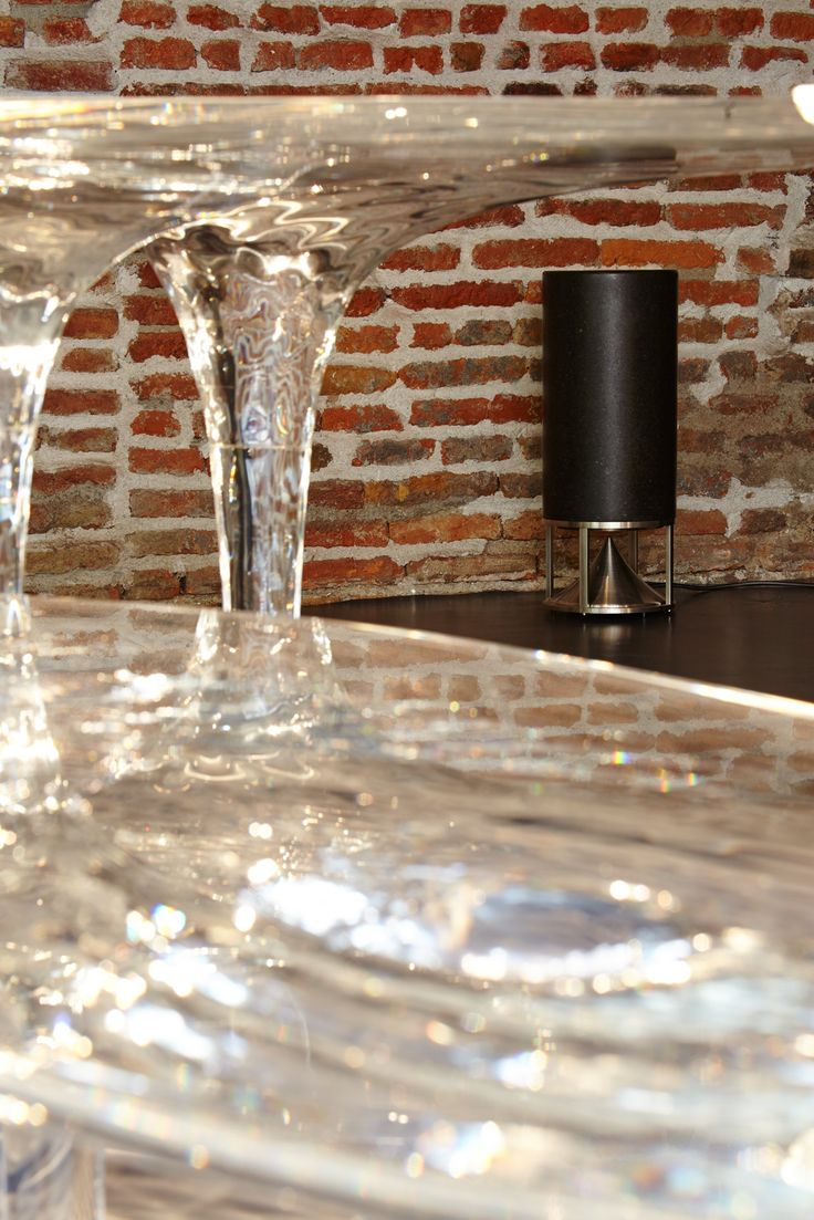 Cylinder in black granite, omnidirectional sound module by Architettura Sonora, the natural sound!